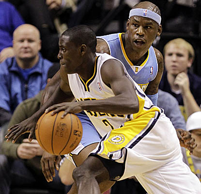 Pacers guard Darren Collison drives past a stunned Al Harrington on his way to 29 points. (Getty Images)