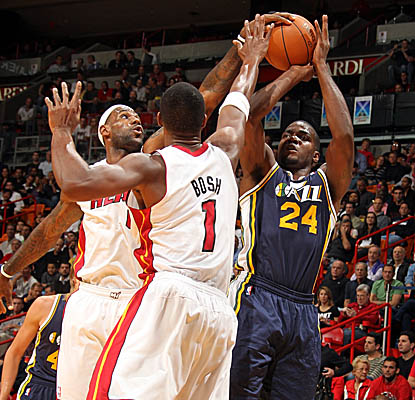 LeBron James gets a hand on this shot, but Paul Millsap's 46 points help bury Miami. (Getty Images)