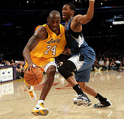 Kobe Bryant slips past Wolves defender Wes Johnson on his way to 33 points. (Getty Images)