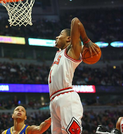 Stephen Curry can only watch as Derrick Rose throws a dunk down with authority in the first half.  (US Presswire)