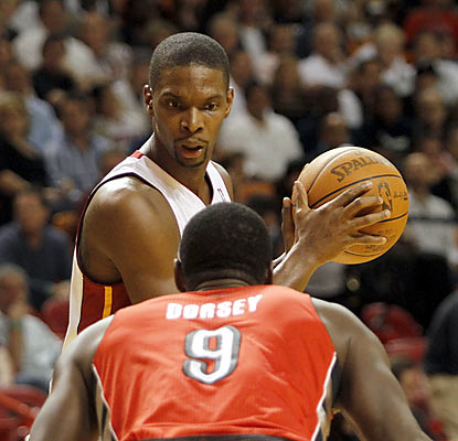 Chris Bosh faces his former team, but manages just 12 points as foul trouble limits him to under 22 minutes of action. (Getty Images)