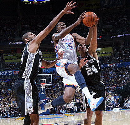 San Antonio defenders help contain Thunder star Kevin Durant to a season low of 23 points. (Getty Images)