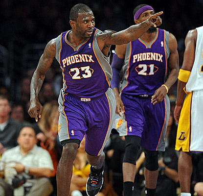Jason Richardson shares the love after hitting for a couple of his 34 points. (Getty Images)