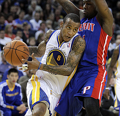 Monta Ellis rips past a Pistons defender on his way to scoring 24 of his 27 points in the first half.  (AP)