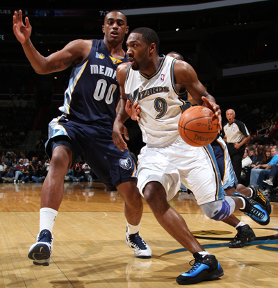 Gilbert Arenas drives past Darrell Arthur of the Memphis Grizzlies on his way to score a game-high 24 points.  (Getty Images)
