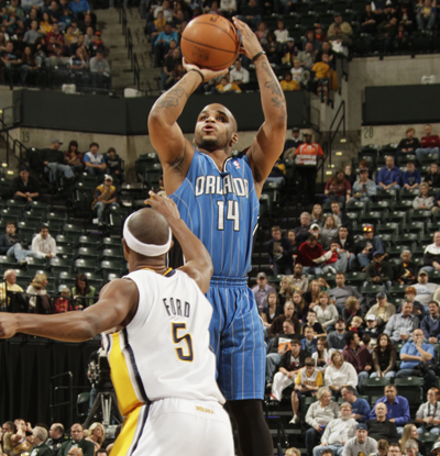Orlando's Jameer Nelson shoots over the Pacers' T. J. Ford before converting the go-ahead three-point play.  (Getty Images)