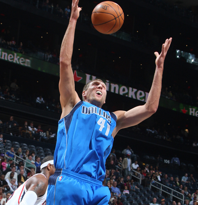 The Mavericks' Dirk Nowitzki -- 21 points -- grabs a loose ball against the Hawks. (Getty Images)