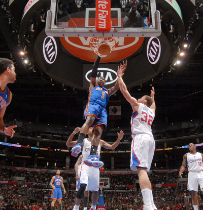 Amar'e Stoudemire dunks against the Clippers' Blake Griffin, who leads all scorers with a career-high 44 points. (Getty Images)