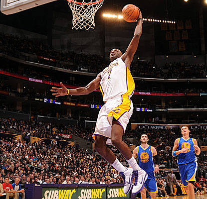 Lamar Odom lifts off for the dunk Sunday against the Warriors. (Getty Images)