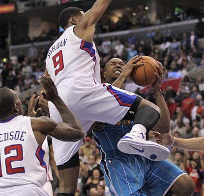DeAndre Jordan and the Clippers get in the way of David West's Hornets, giving New Orleans its second loss.  (AP)