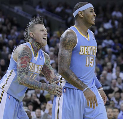 Chris Andersen can feel the heat radiating off Carmelo, who pours in 39, including 17-of-17 from the charity stripe.  (AP)