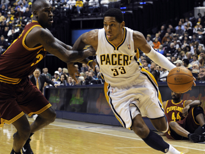 Danny Granger -- 24 points -- drives past Cavaliers forward Jawad Williams.  (AP)