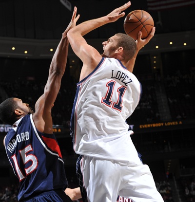 Brook Lopez -- 32 points -- drives to the hole against the Hawks' Al Horford. (Getty Images)