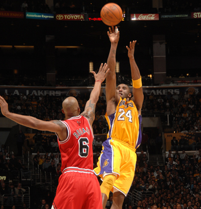 Kobe Bryant, who winds up with 20 points, shoots a fadeaway jumper over the Bulls' Keith Bogans.  (Getty Images)