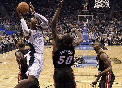 Dwight Howard overpowers the Heat by providing 24 points and 18 rebounds in a strong showing by the Magic.  (AP)