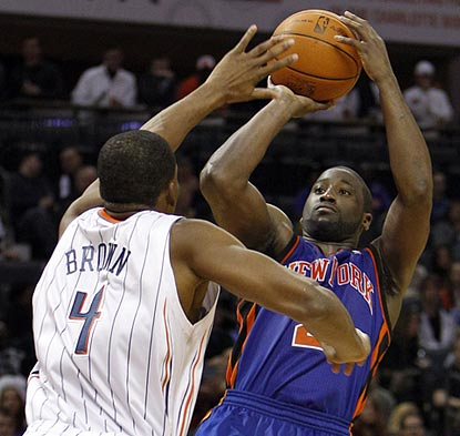 Raymond Felton, shown shooting over Derrick Brown, leads New York in scoring but the last of his three rebounds is a huge play. (AP)