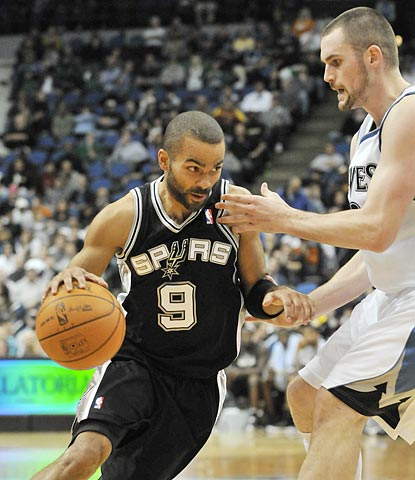 Kevin Love (right) has another monster game, but neither he nor any of his teammates can stop Tony Parker in crunch time.  (AP)