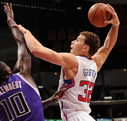 Blake Griffin goes up and overpowers Samuel Dalembert for a basket. Griffin finishes with 25 points and 15 boards. (Getty Images)