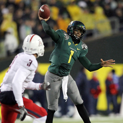 The Ducks QB Darron Thomas passes for 148 yards and three TDs -- he rushes for one more.  (AP)
