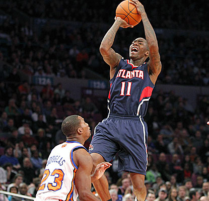 Jamal Crawford shoots over Toney Douglas for two of his 21 points off the bench. (AP)