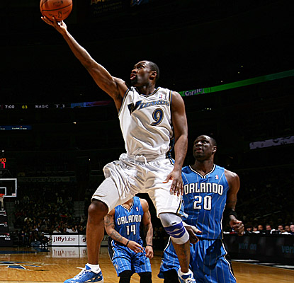 Washington's best scorer Saturday, Gilbert Arenas, drives past a Magic defender. (Getty Images)