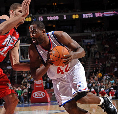 Elton Brand helps the Sixers wrap up the Nets with 14 points and 10 boarrds. (Getty Images)