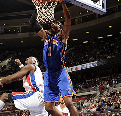 Amar'e Stoudemire jams it home on his way to 37 points and 15 boards at The Palace on Sunday. (Getty Images)