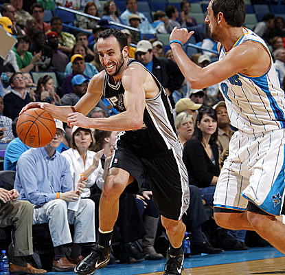 Manu Ginobili drives past Hornets defender Marco Belinelli, racking up a game-high 23 points. (Getty Images)