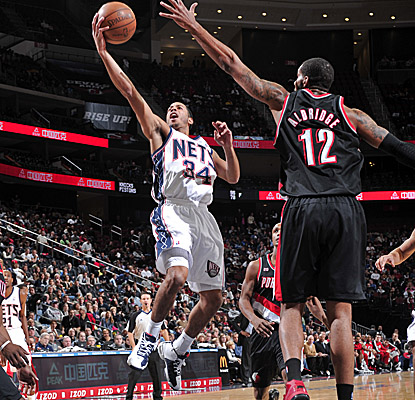 Devin Harris looks to lay it in, scoring two of his game-high 25 points vs. Portland. (Getty Images)