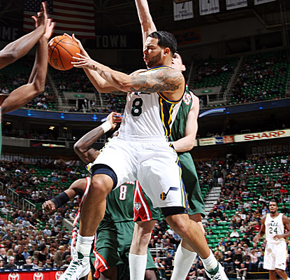 Deron Williams dishes in traffic and finishes with 22 points as the Jazz paste the Bucks on Monday.  (Getty Images)