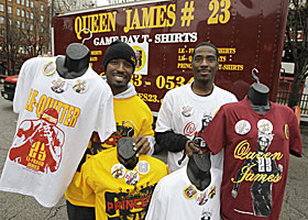 Enterprising Cavs fans sell 'Queen James 23' shirts in Cleveland in advance of James' return. (AP)