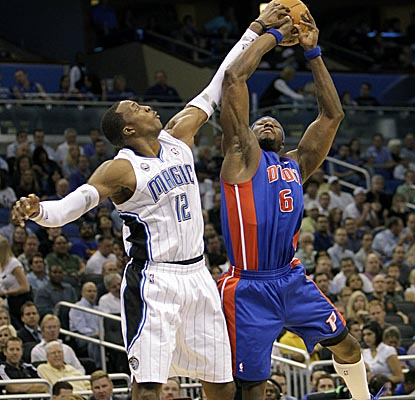 Held to nine points, Dwight Howard comes up with one of his two blocks vs. the Pistons on Tuesday. (AP)