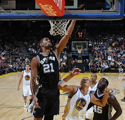 Tim Duncan pours in two of his 15 points, part of his first triple-double since May of '08.  (Getty Images)