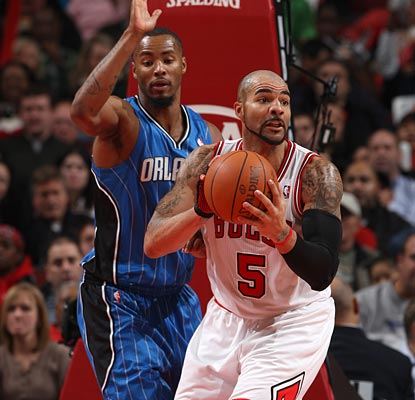 The Magic bottle up Carlos Boozer, who scores just five points with two rebounds in 22 minutes.  (Getty Images)