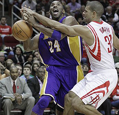 Shane Battier knocks the ball away from Kobe Bryant and goes on a late scoring run to help sink the Lakers. (AP)