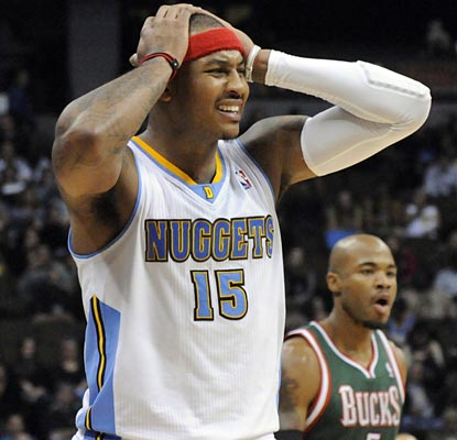 Carmelo Anthony shows his disbelief after being called for one of his two technicals in the game.  (AP)
