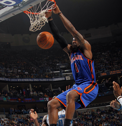 Amar'e Stoudemire slams two of his 34 points home to help lift the Knicks over the Hornets. (Getty Images)