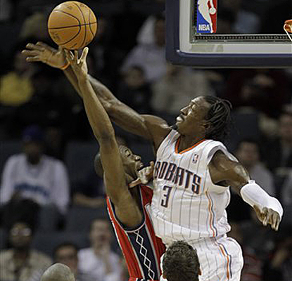 Gerald Wallace collects one of his five blocks of the game during the Bobcats' overtime win over the Nets. (AP)