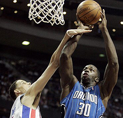 Brandon Bass takes a shot against Austin Daye on his way to scoring a career-high 27 points as the Magic beat the Pistons. (AP)