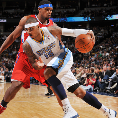 Carmelo Anthony drives to the basket on his way to score 26 against a struggling Clippers team.  (Getty Images)