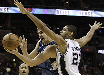 Tim Duncan plays defense on Darko Milicic of the Wolves but also scores 22 points in the Spurs' win. (AP)