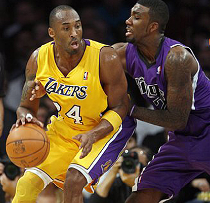 Kings forward Donte Greene tries to slow down Kobe, but Bryant finishes the game with 22 points in the Lakers' win. (AP)