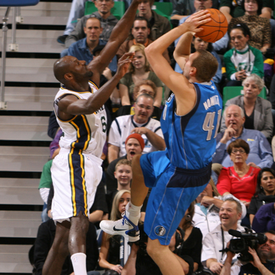 Dirk Nowitzki -- 26 points and six rebounds -- goes up for the shot over Francisco Elson of the Utah Jazz. (Getty Images)