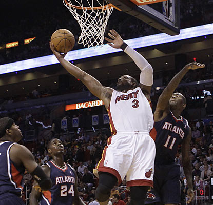 Atlanta players can only watch as Dwyane Wade dazzles the home crowd with a 26-point, 10-rebound performance. (AP)