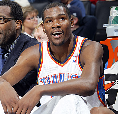 Kevin Durant takes a breather in his first game back after injuring his knee. (Getty Images)