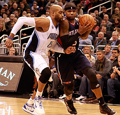 Josh Smith muscles past Magic forward Vince Carter, punctuating Atlanta's win with 19 points and 13 rebounds. (Getty Images)