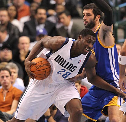 The Mavs get the contributions from the regulars, but Ian Mahinmi chips in with 12 points and 10 boards.  (US Presswire)