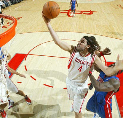 Luis Scola is a monster against the Pistons, hauling in 12 rebounds to complement his 35-point outburst.  (US Presswire)