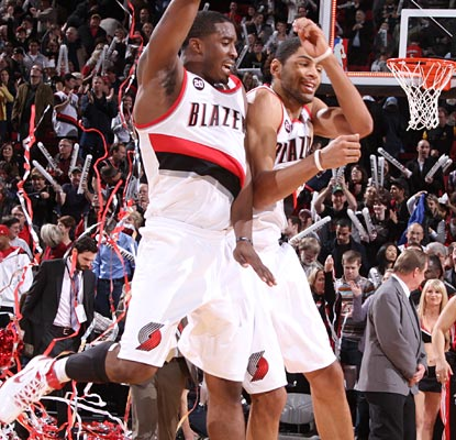 Party time! Nicolas Batum (left), Wesley Matthews and the Blazers celebrate their come-from-behind win.  (Getty Images)