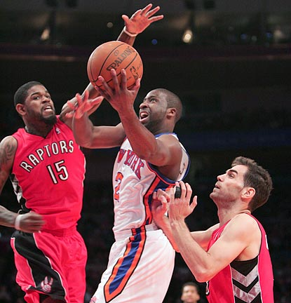 In the first half, eventual game hero Raymond Felton drives past Toronto's Amir Johnson (15).  (US Presswire)